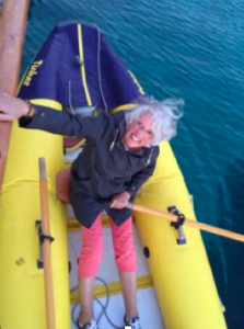 One of the older women rowing the dinghy back