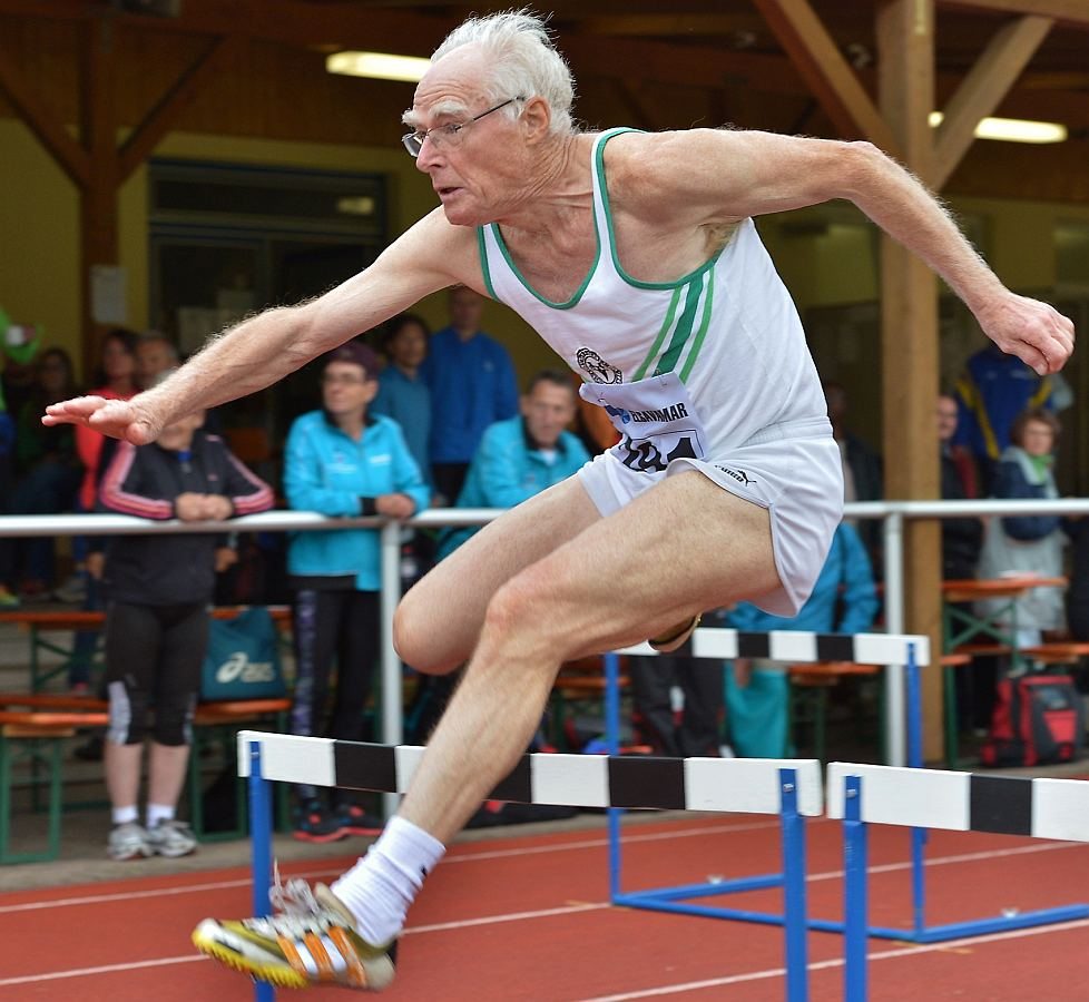 Jumping over hurdles in a race at 84 years old