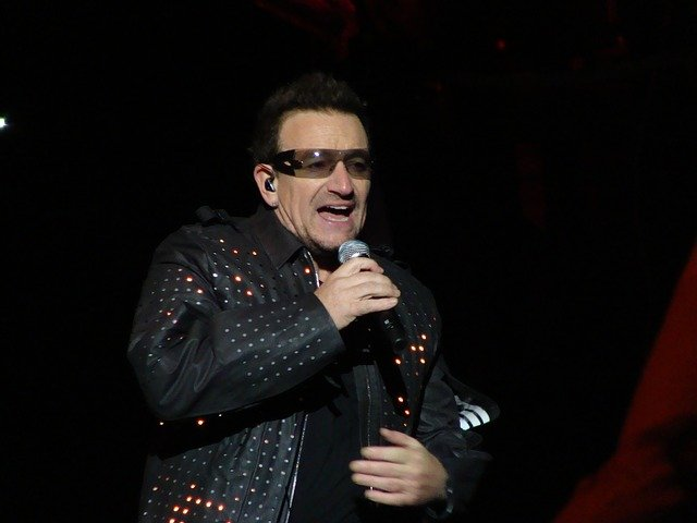 Bono with his wraparound glasses - like blue light filtering glasses, which help you sleep better.