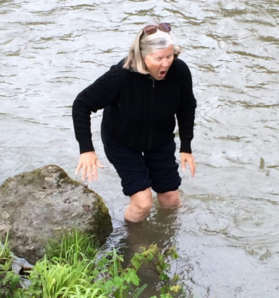 Wading in a freezing mountain stream for health benefits