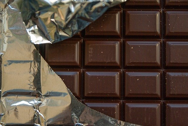 A big bar of chocolate tempting you to eat too much.  A small dose has a beneficial hormetic effect on your heart