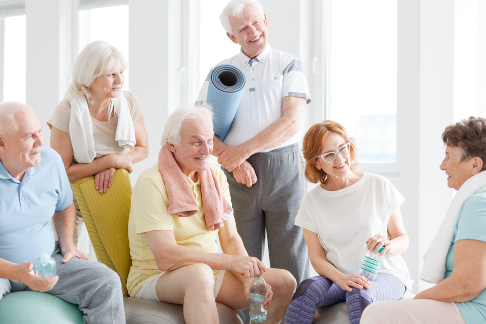 Sympathetic friends listening to and supporting their friend in yoga
