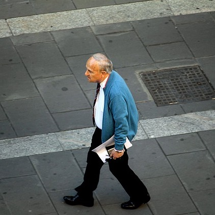 Man walking with his head poked forward which could end up giving him problems