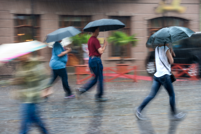 walking in the rain with umbrellas means ready for bad weather